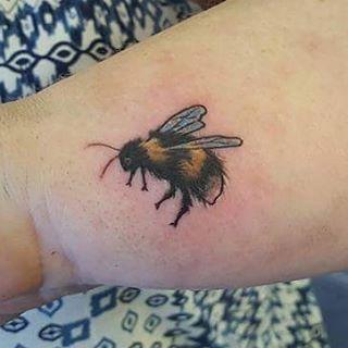 Tiny bee tattoo by @joshhingston11
