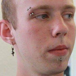 Double eyebrow piercing.