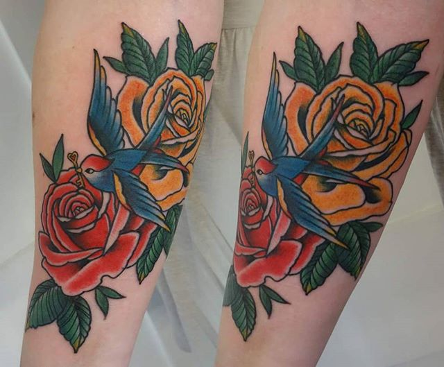 Roses and swallow by @t.brookstattoos