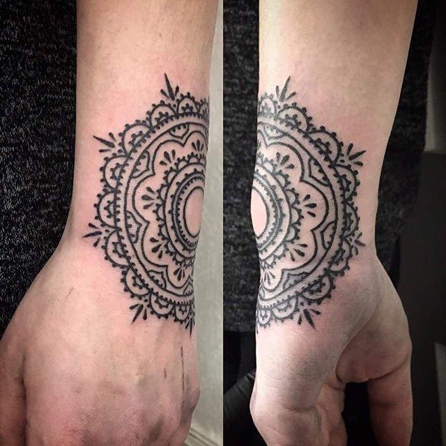 Hand/wrist mandala by @t.brookstattoos